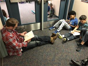 Principal Kyner reading with students.