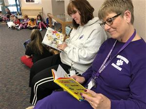 Front office staff participates in the all school read.