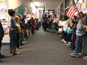 Students form parade for vets.