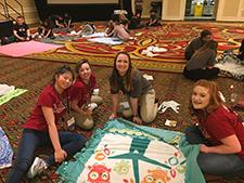 Falcon HOSA students make a blanket for a patient at Children's Hospital.