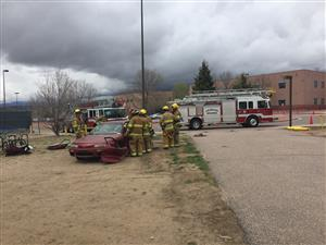 Colorado Springs Fire Department firefighters conduct a mock crash at Sand Creek High School 4/26.