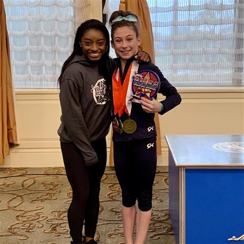 Ariana Leedy, eighth-grader at SSAE and gymnast, meets Olympic champion Simone Biles.
