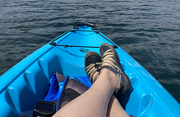 Dr. Kim Boyd takes time for self-care on a kayak trip.