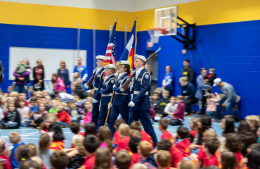 Falcon High School Color Guard in action at Falcon Elementary Veterans Day Celebration