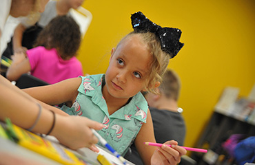 Kyneigh Martin, BRES third-grader, completes an assignment on the first day of school, August 2.