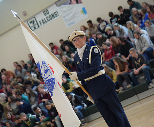 Cadet Cayden Viera presents the U.S. Army flag during Veterans Day festivities at FHS Nov. 11.
