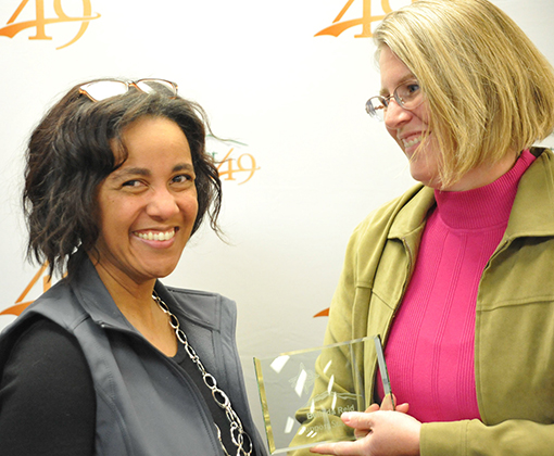 Belinda Reid from EIES accepts her Support Star award Nov. 20 from BOE president.