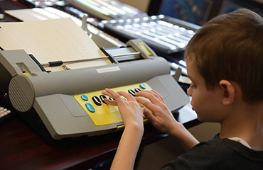 Student participates in nationwide Braille Challenge competition.