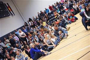 A large crowd spilled out of the bleachers for the Grand Peak Academy ribbon cutting ceremony Oct. 25