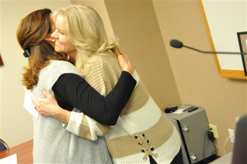 Mary Velasquez, IGNITE expeditions project manager, congratulates Patsy Prettyman, lead nurse, during Fantastic 49 Feb. 13.