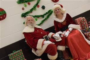 Santa and Mrs. Claus attend the holiday party for foster kids at HMS Dec. 14.