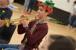 Mathias Panetti, seventh-grader, plays holiday music at the holiday party at HMS Dec. 14.