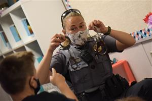 Deputy Lora Robblee from the El Paso County Sheriff's Office shows students her handcuffs at Evans Elementary Oct. 6.