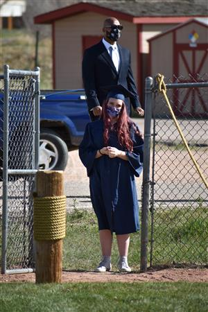PHS senior Brittney Merthen waits to receive her diploma May 23