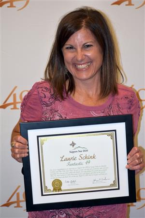 Laurie Schink with SSAE and PPEC is celebrated during the Fantastic 49 presentation Aug. 13.