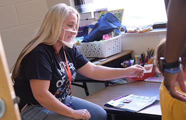 Lisa McCann, paraprofessional, provides individual support for a student at Stetson Elementary.