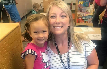 Nicole Croney, paraprofessional, with a student at Woodmen Hills Elementary.