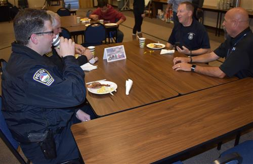 CSPD members sit with D49 safety and security specialist David Pratt for the Sunrise Salute, Oct. 11