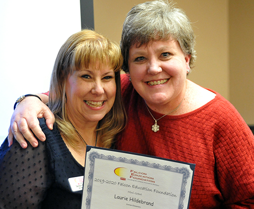 Laurie Hildebrand receives kudos as a Falcon Education Foundation mini grant recipient Dec. 12.