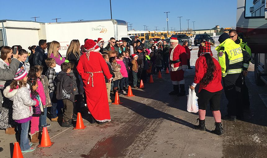 Santa arrives at the District 49 Education Success Center during Santa's Toy Express.
