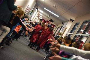 graduates being high-fived at SRES