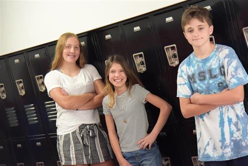 Zoe Maher, Isabella Cruz and Martin Depner, eighth-graders (left to right), start new year at HMS Aug. 1.