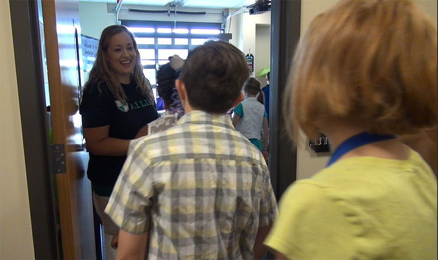 ALLIES teacher Stephanie Hazelton greets her students.