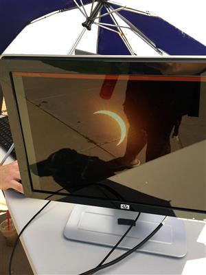 A monitor provides a safe way for students at ALLIES to view the eclipse Aug. 21 at their school.