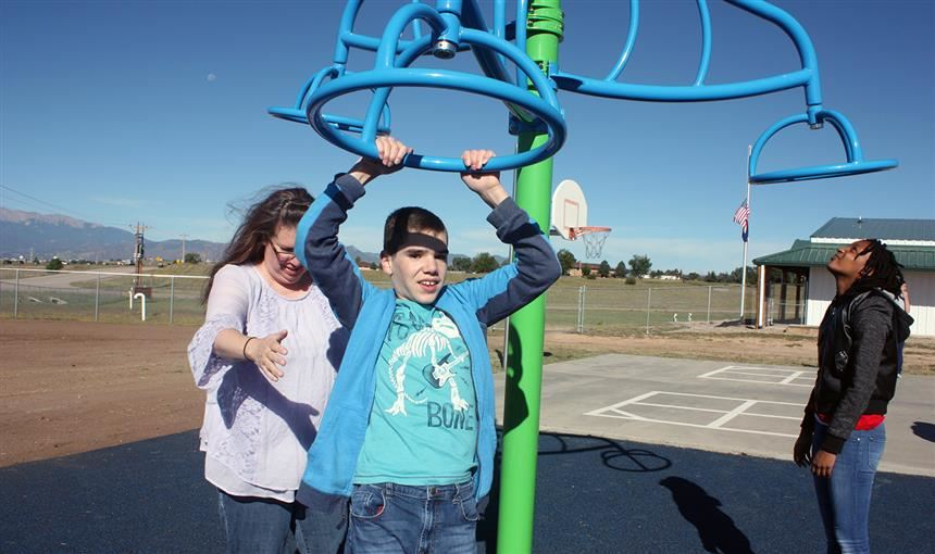 Students try out new playground with their teacher Aug. 30 at the PEAK Education Center.