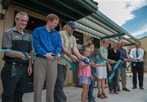 School leaders and project managers line up with students for ALLIES ribbon-cutting, July 25.