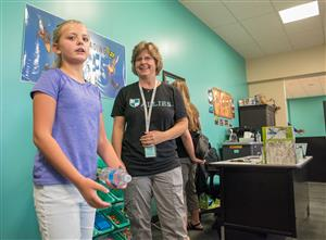ALLIES staff welcome visitors to tour their classrooms after ALLIES ribbon-cutting, July 25.