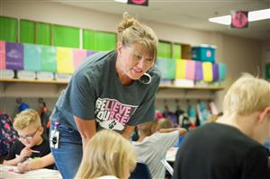 Heidi McClure, RVES second-grade teacher, works with students on the first day of school, August 3