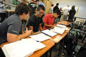 FHS Juniors James Starner, Jackson Sakuvich and Ben Ramirez (left to right) work out calculations in physics 1