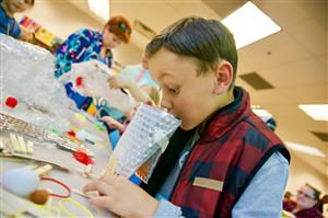Brady Hedrick, RES second-grader, examines his Egg Drop design