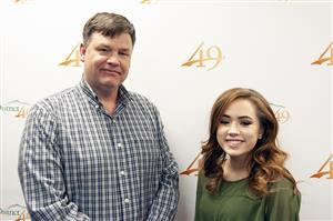 Cambria Carpenter, VRHS senior, with John Graham, BOE VP, before Fantastic 49 celebration Dec. 13.