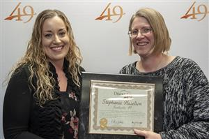Stephanie Hazelton, innovation professor at ALLIES, receives a plaque from Marie La Vere-Wright, BOE president, Feb. 14.