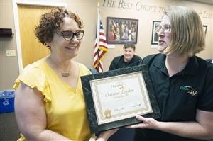 Christine Logsdon, SMS teacher, receives accolades from BOE President Marie La-Vere Wright during Fantastic 49 March 27.