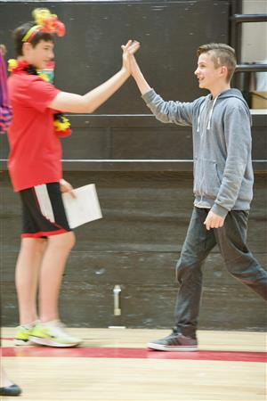 FMS seventh-grader Gavin Adams (right) gets a high-five for winning a Space Camp scholarship, April 5.