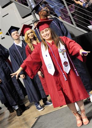 Sand Creek graduate prepares to enter the arena for ceremonies May 25.