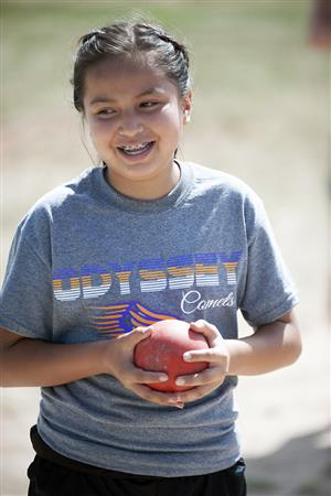 Taylor Yazzie is happy with her shot put skills at the district track meet May 17 at FHS.