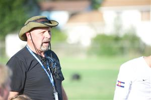 Dave Pratt, D49 Safety and Security Officer, coaches players during a SeSSI summer soccer game