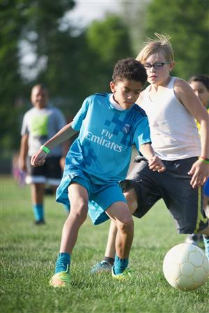 Brandon Hinds, HMS sixth-grader, battles for the ball during a SeSSI soccer game on July 2