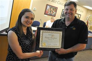 Rachel Washburn, senior at SCHS, receives honors from the BOE during Fantastic 49 June 13.