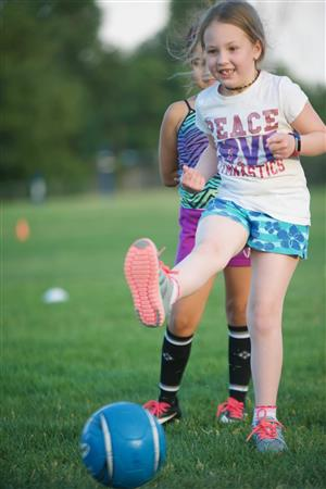 Abby Koch, EIES second-grader, scores a goal during a SeSSI skills lesson on July 2