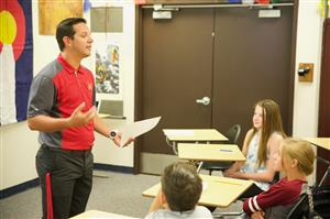 Daniel Russell, FMS social studies teacher, hands out assignments on the first day of school