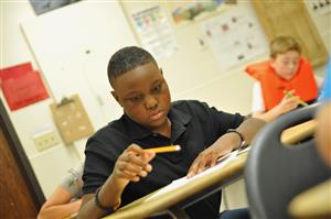 FMS student Deuce Gilbert works on an assignment on the first day of school