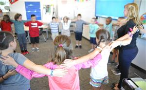 Third-graders at IVES participate in group activity on the first day of school, August 2