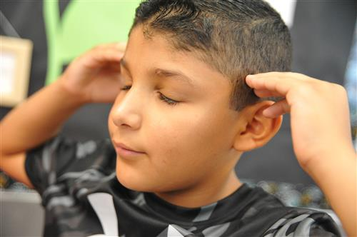Third-grade student Johnathan Romero practices the Actor's Toolbox method of imagination, August 2