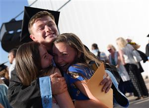 Diploma in hand, VRHS grad hugs friends after commencement ceremony May 25 at the Broadmoor World Arena