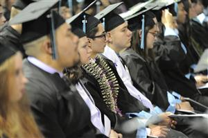 VRHS seniors listen to remarks during graduation ceremony at Broadmoor World Arena May 25